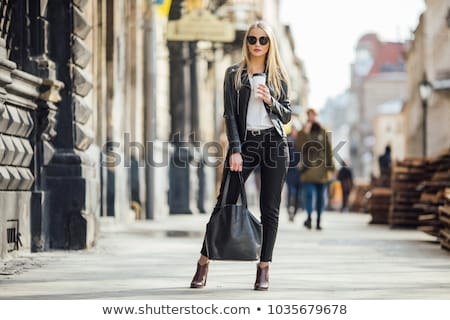 Urban Fashion. Styled woman in Elegant Trendy Dress standing. Poster Design stock photo © gromovataya