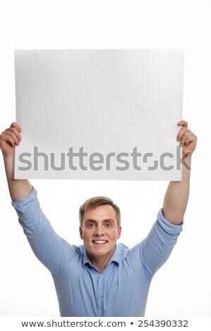 Businessman holding up a blank sign Stock photo © smithore