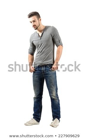 casual man looks down with hand in pocket stock photo © feedough