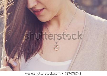 woman wearing shiny diamond pendant Stock photo © dolgachov