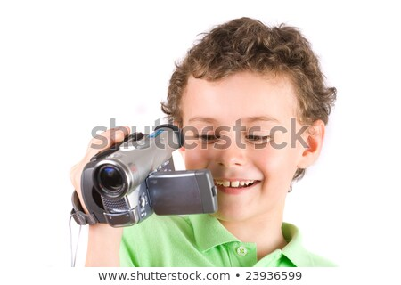 Young boy with camcorder on white background Stock photo © papa1266