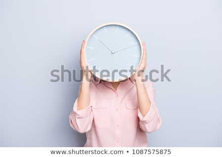 Woman with a clock face Stock photo © AndreyPopov
