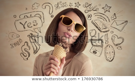 young pretty woman thinking of her plans eating icecream and ha stock photo © hasloo