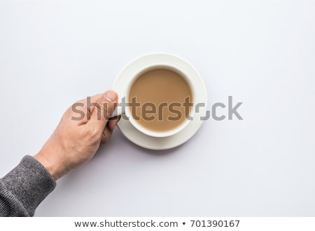 close up coffee cup in hand on isolate background Stock photo © yanukit