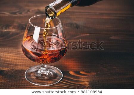 Brandy mesa cigarro cenicero mesa de madera moda Foto stock © Givaga