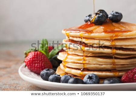 homemade pancakes pile on plate Stock photo © ozaiachin