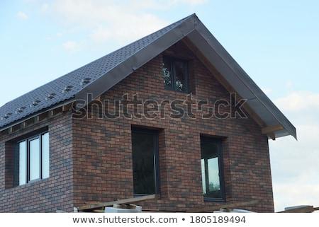 Beyaz ev kahverengi çatı soyut mavi bulutlar Stok fotoğraf © cherezoff