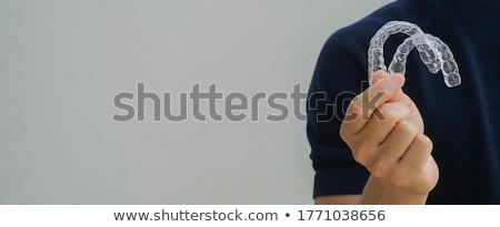 homem · dentista · mostrar · dentes · cirurgia · dentária - foto stock © d13