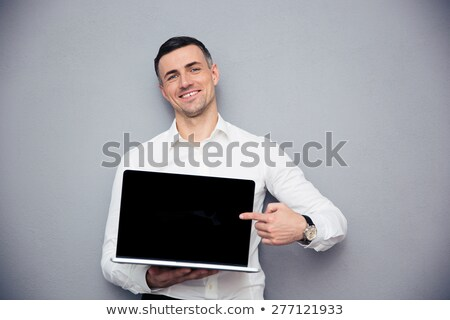 businessman pointing finger on the laptop screen stock photo © deandrobot