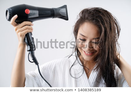 Beautiful brunette woman with hair dryer. Stock photo © nenetus