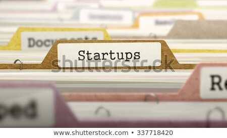 Startups Concept on Folder Register. Stock photo © tashatuvango