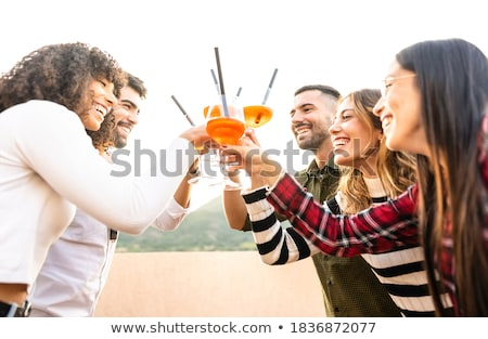 man and woman clink glasses on sunset outside Stock photo © Paha_L