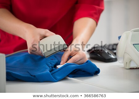 Saleswoman Scanning Barcode On Tshirt Stock photo © AndreyPopov