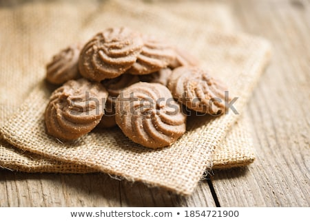 Cookies on a white plate on a sacking on a wooden background Stock photo © vlad_star