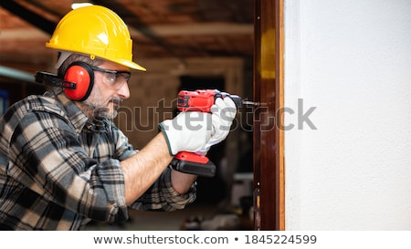 Leveling tool in front of construction worker Stock photo © zurijeta