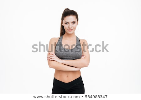 sports woman standing with arms folded and looking at camera stock photo © deandrobot