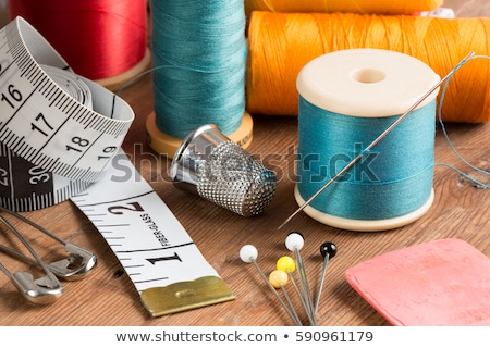 still life of spools of thread and scissors sewing tools and a stock photo © yatsenko
