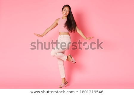 young pretty asian woman posing cheerful emotional isolated on white background lifestyle people co stock photo © iordani