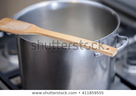 wooden spoon over wood background stock photo © stephaniefrey