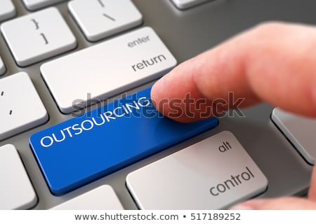 outsourcing key on blue button 3d stock photo © tashatuvango
