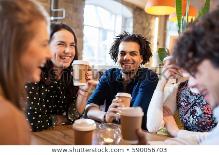 young customers drinking coffee at cafe stock photo © wavebreak_media