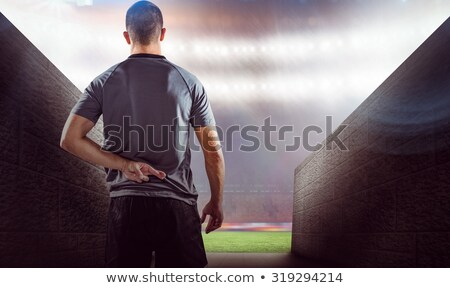 Rear view of rugby player with fingers crossed Stock photo © wavebreak_media