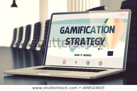 laptop screen with gamification strategy concept 3d stock photo © tashatuvango