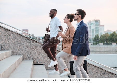 Man and woman walking up stairs Stock photo © IS2