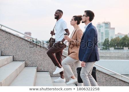 молодые · бизнесмен · ходьбе · вверх · лестницы - Сток-фото © is2