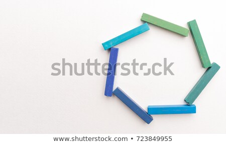 close up of colorful chalks in geometric composition stock photo © deandrobot