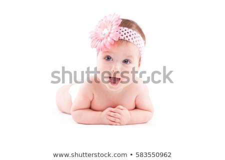 beautiful cute baby girl in pink flower wrap lies on tummy Stock photo © Traimak