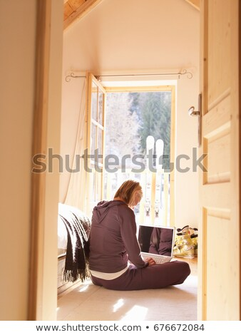 woman on laptop in bedroom of chalet Stock photo © IS2