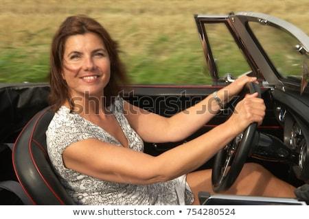 Kadın spor araba seyahat eğlence hızlandırmak Stok fotoğraf © IS2