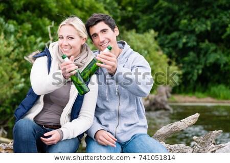 homem · água · potável · garrafa · praia · paisagem · moço - foto stock © kzenon
