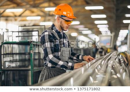 Operário de fábrica olhando fora janela mulher parede Foto stock © IS2