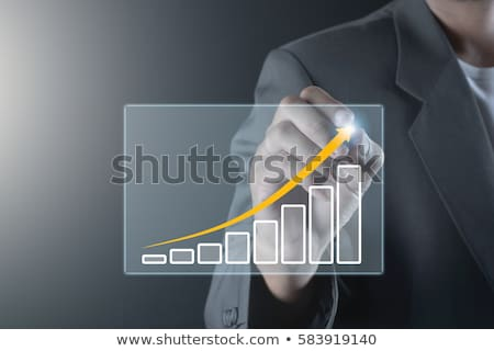 Businessman drawing arrow pointing up Stock photo © stevanovicigor