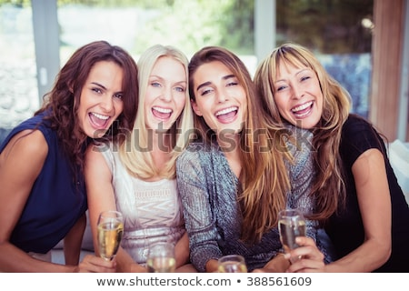Young woman holding champagne flute, portrait Stock photo © IS2