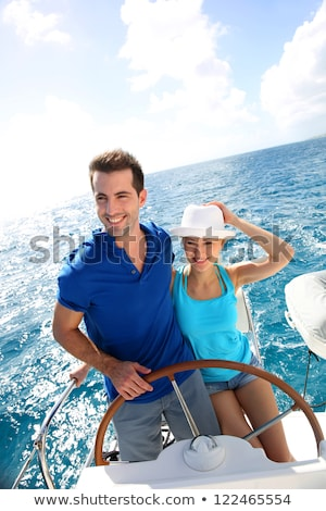 Man steering yacht smiling Stock photo © IS2