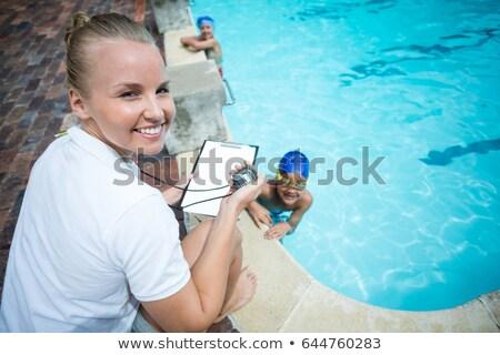 Instructor tiempo ninos piscina agua Foto stock © wavebreak_media