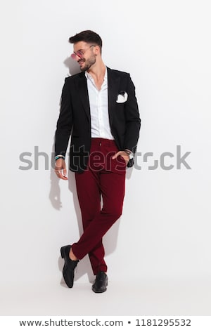smiling stylish man looking relaxed while holding glasses stock photo © feedough