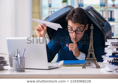 The employee thinking of vacation due to excessive workload Stock photo © Elnur