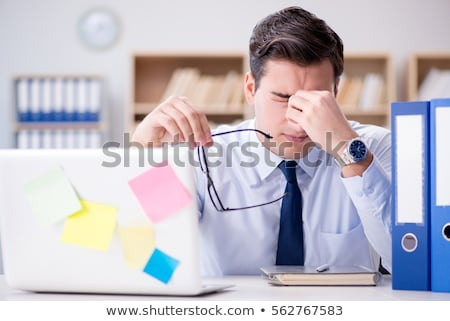 stressed male office worker and overdue deadline stock photo © robuart
