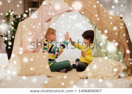 boys playing clapping game in kids tent at home stock photo © dolgachov
