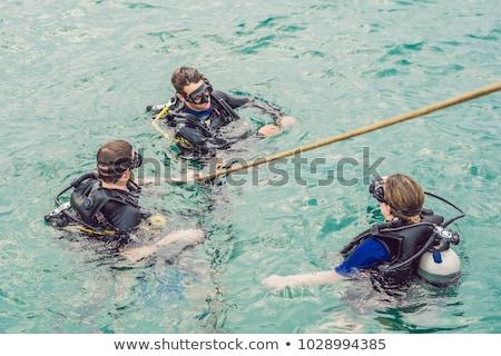 Oppervlak water klaar duik vrouw man Stockfoto © galitskaya