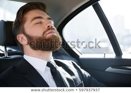 Közelkép portré kimerült fiatal üzletember öltöny Stock fotó © deandrobot