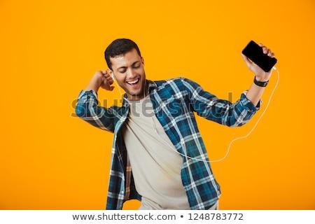 Izgatott fiatalember visel kockás póló áll Stock fotó © deandrobot