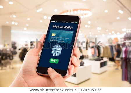 Mobilephone With Online Banking App And Credit Cards Stock photo © AndreyPopov