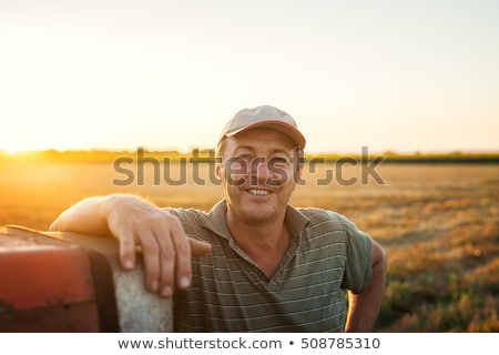 Happy farmer at farmland Stock photo © colematt