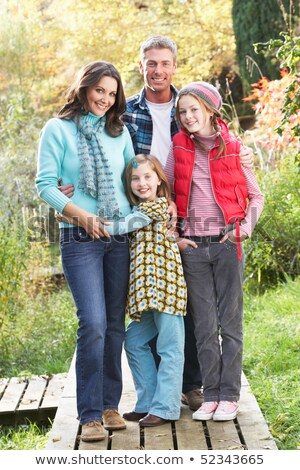 Father And Children Standing Outdoors On Wooden Walkway In Autum Stock photo © monkey_business