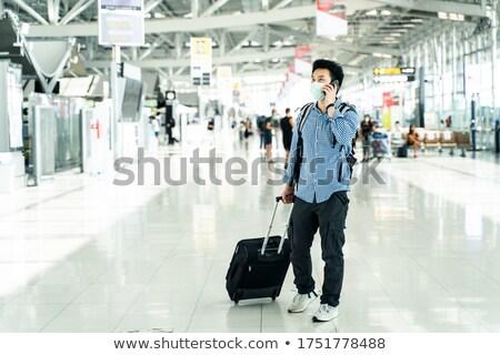 Czasu podróży człowiek bagażu smartphone odizolowany Zdjęcia stock © robuart